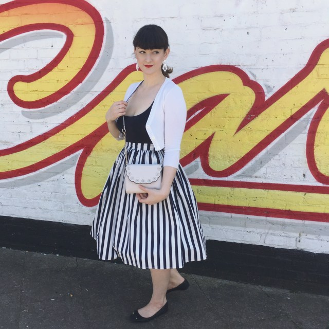 jasmine skirt from collectif in front of mural in east london