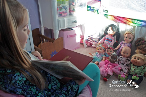 Using her bedroom space to read to the babies