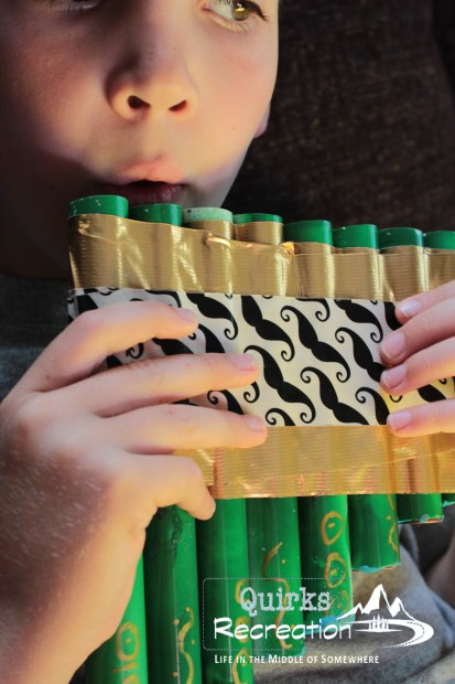 Playing a tune on the homemade pan flute