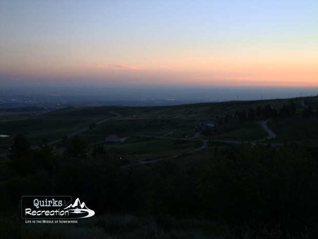 sun beginning to illuminate the town as seen from mounatin trail