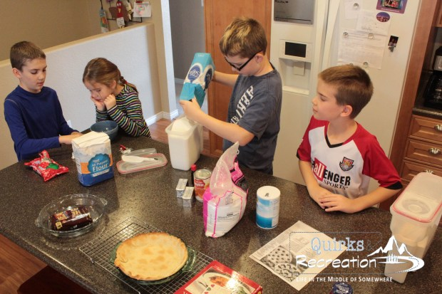 Four children baking in the kitchen