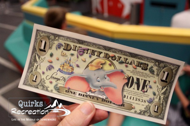 a $1 Disney Dollar bill with Dumbo