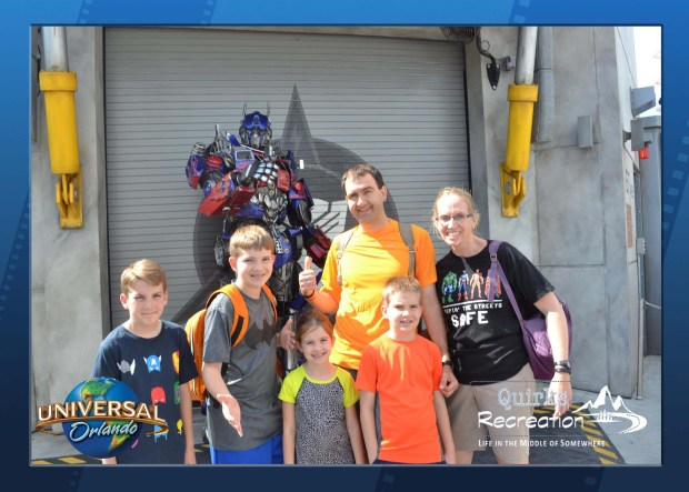 family posing with Optimus Prime Universal Studios
