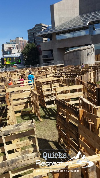 children going through a pallet maze