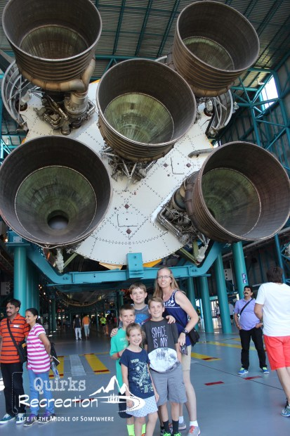 family posing with largest rocket ever flown Kennedy Space Center