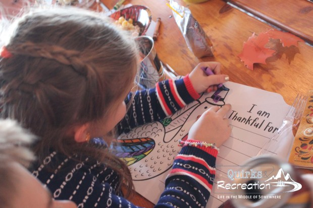 girl coloring a Thanksgiving turkey placemat