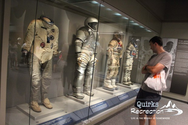 man looking at spacesuits at Kennedy Space Center