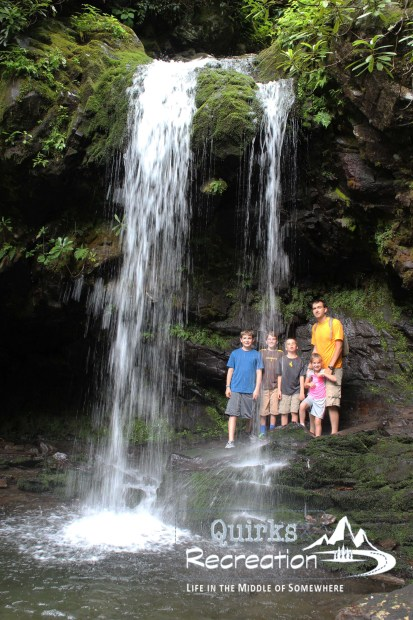 family hiding behind waterfall Great Smoky Mountains