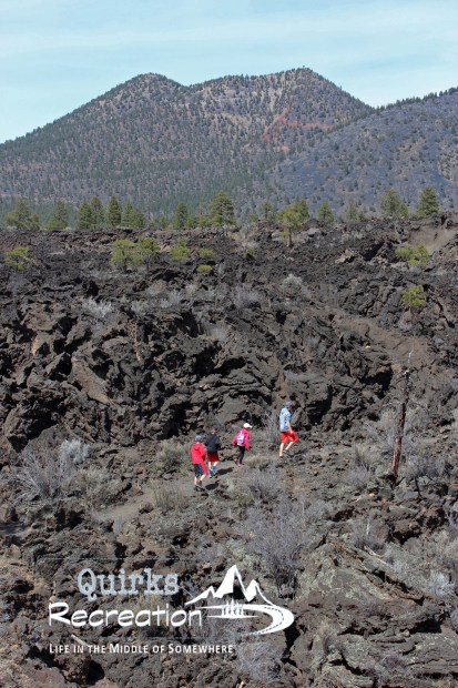children hiking on lava flow trail Sunset Crater