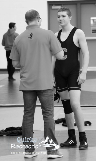 coach talking with wrestler