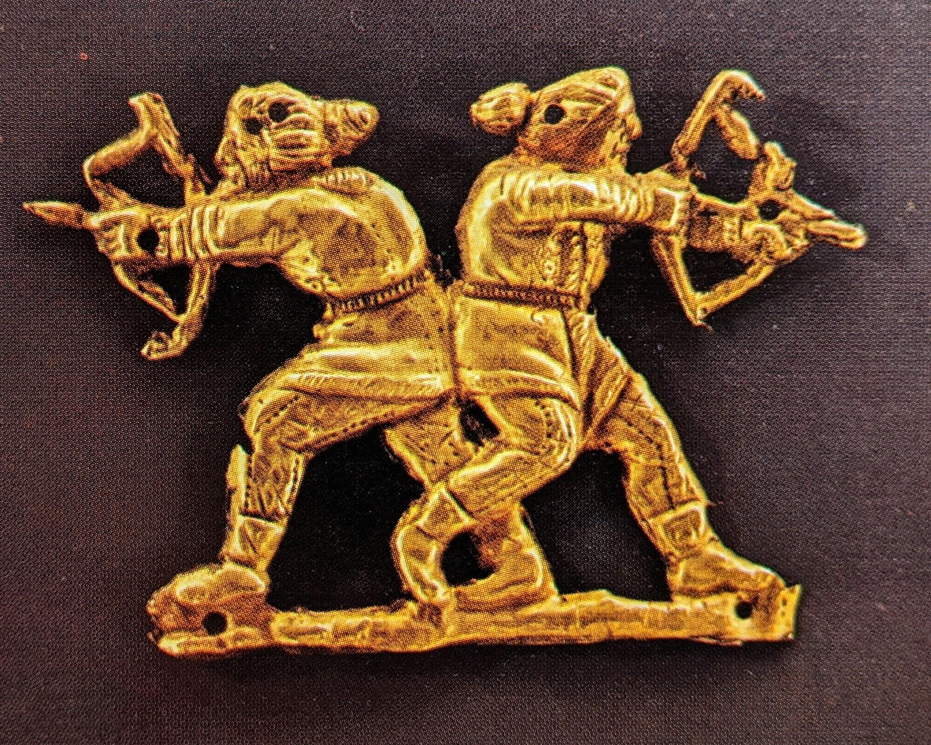 Two archers gold applique plaque