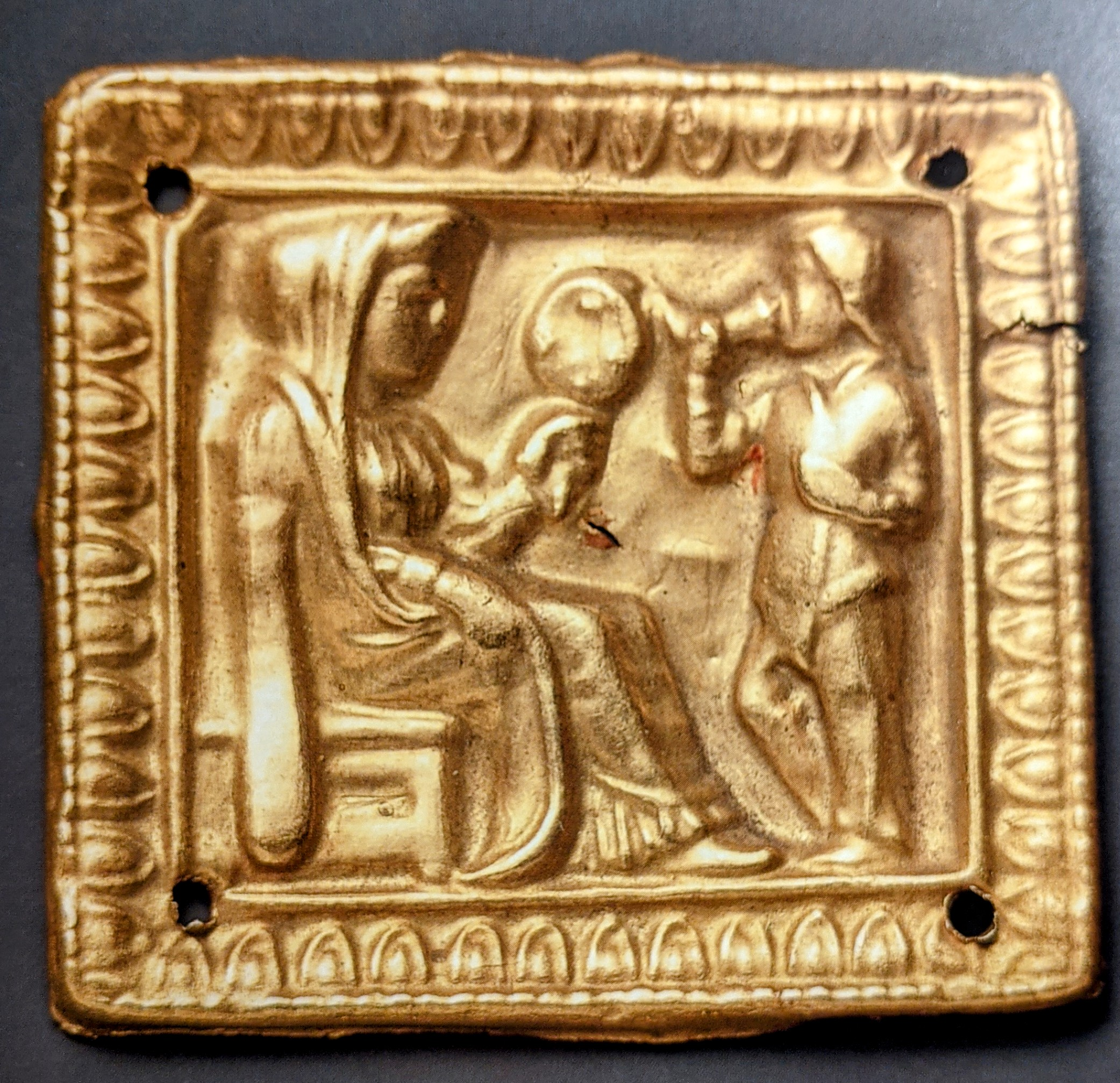 Female deity and drinking man gold applique plaque