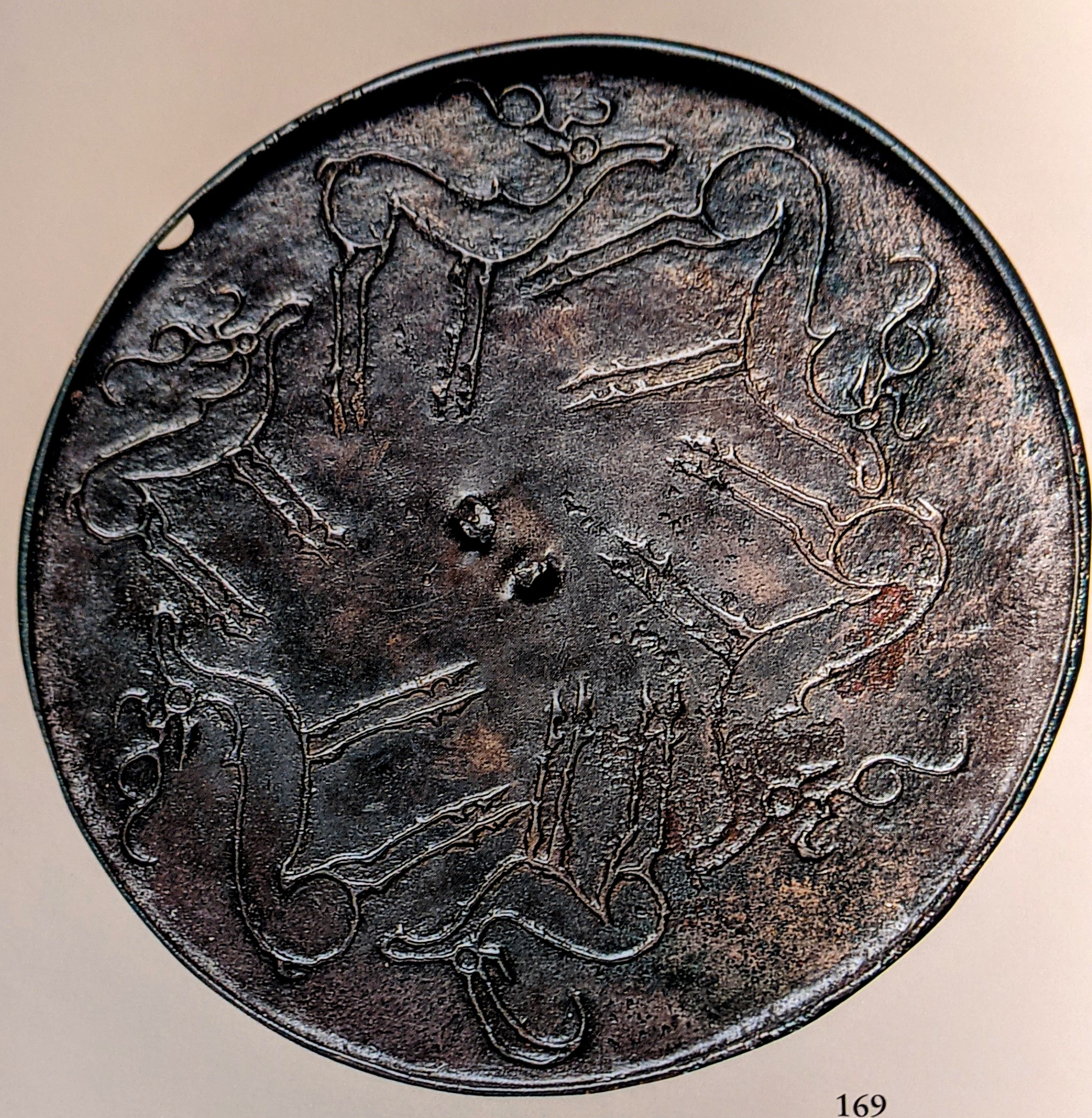 Bronze mirror with stags and goat