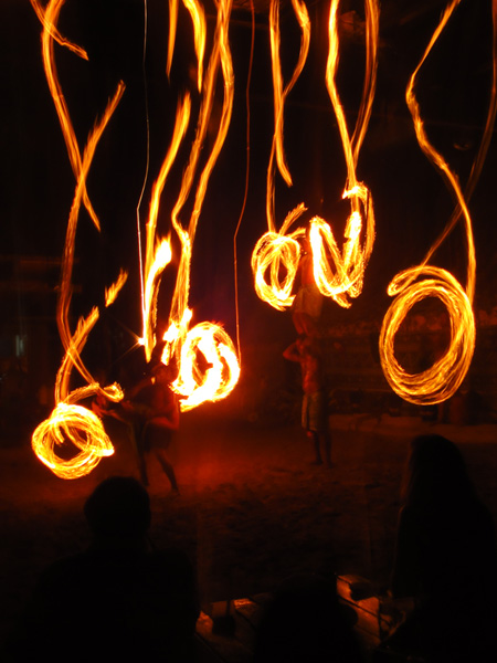 Swirls of light caught from Fijian dancers spinning fire batons