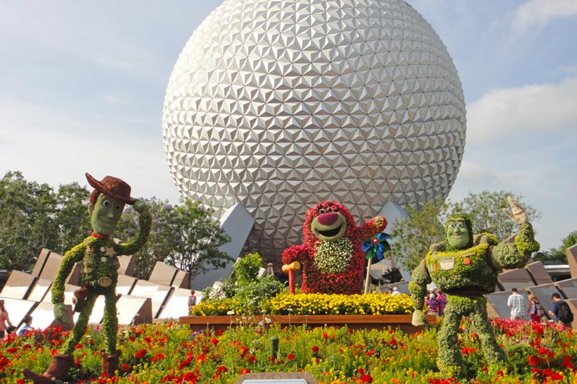 Spaceship Earth at Epcot featuring Toy Story topiary for the Flower and Garden Festival