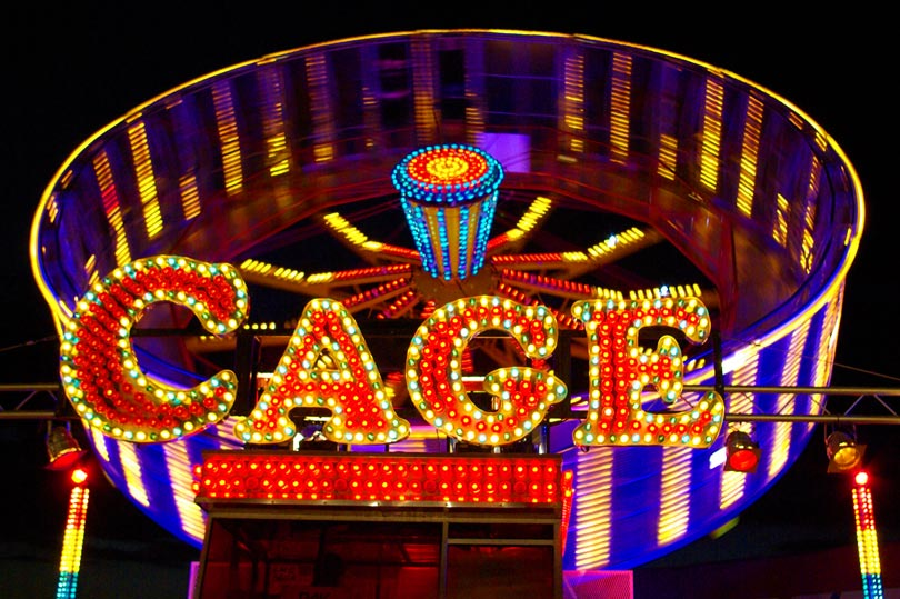 Fun photo challenge - Cage funfair ride lit up at night
