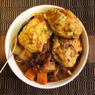 Black bean and quinoa stew with herby dumplings