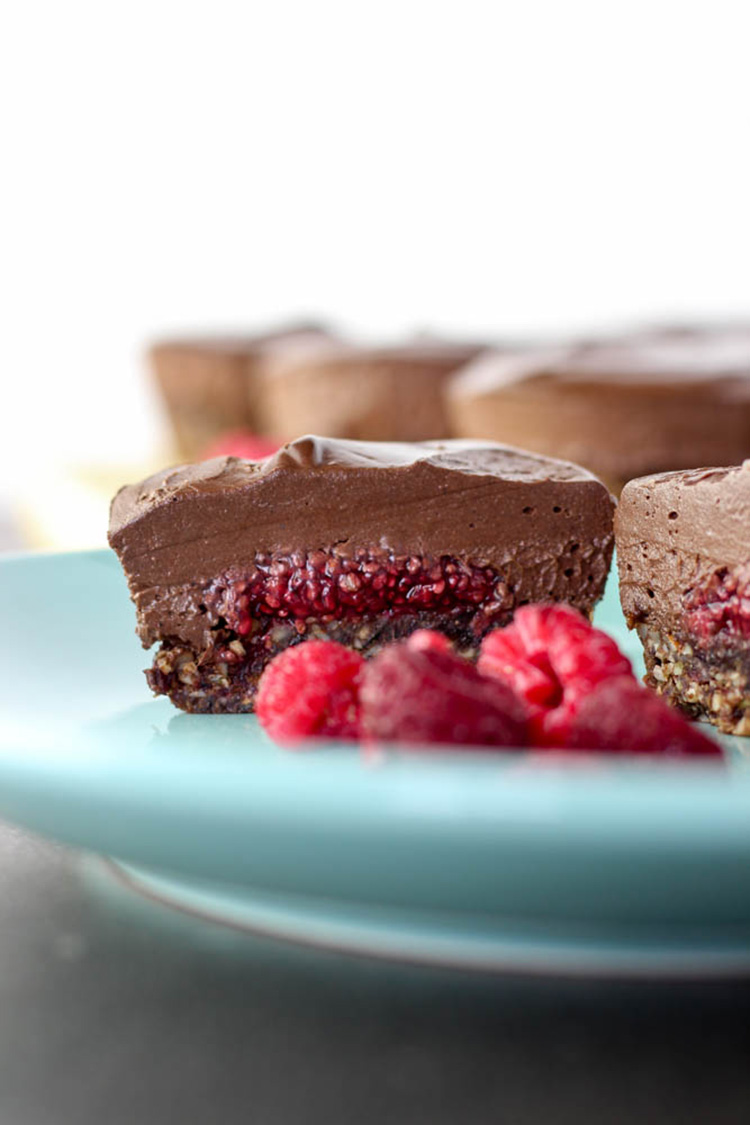 Chocolate and raspberry mini cheesecakes.