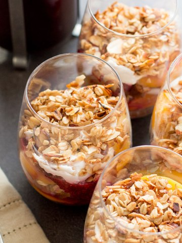 Peach melba breakfast trifle: peaches, raspberry chia jam, coconut yoghurt and granola layered with cake.