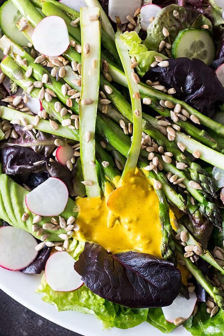 Asparagus salad with turmeric tahini dressing (vegan and gluten free).