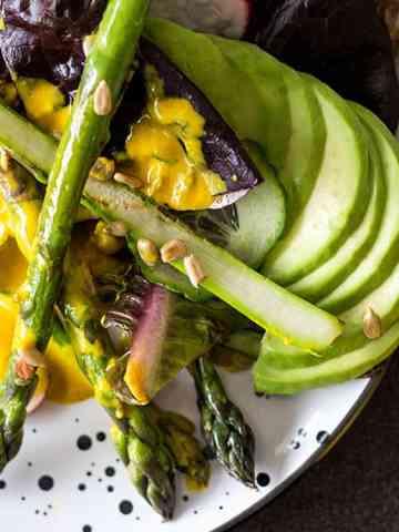 Asparagus salad with turmeric tahini dressing.