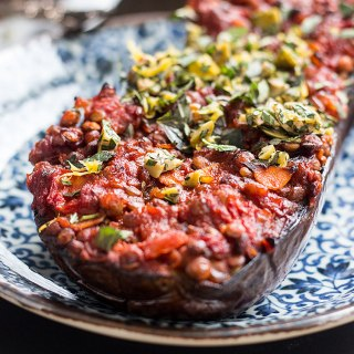 Baked eggplant with lentils, tomatoes and a herby topping