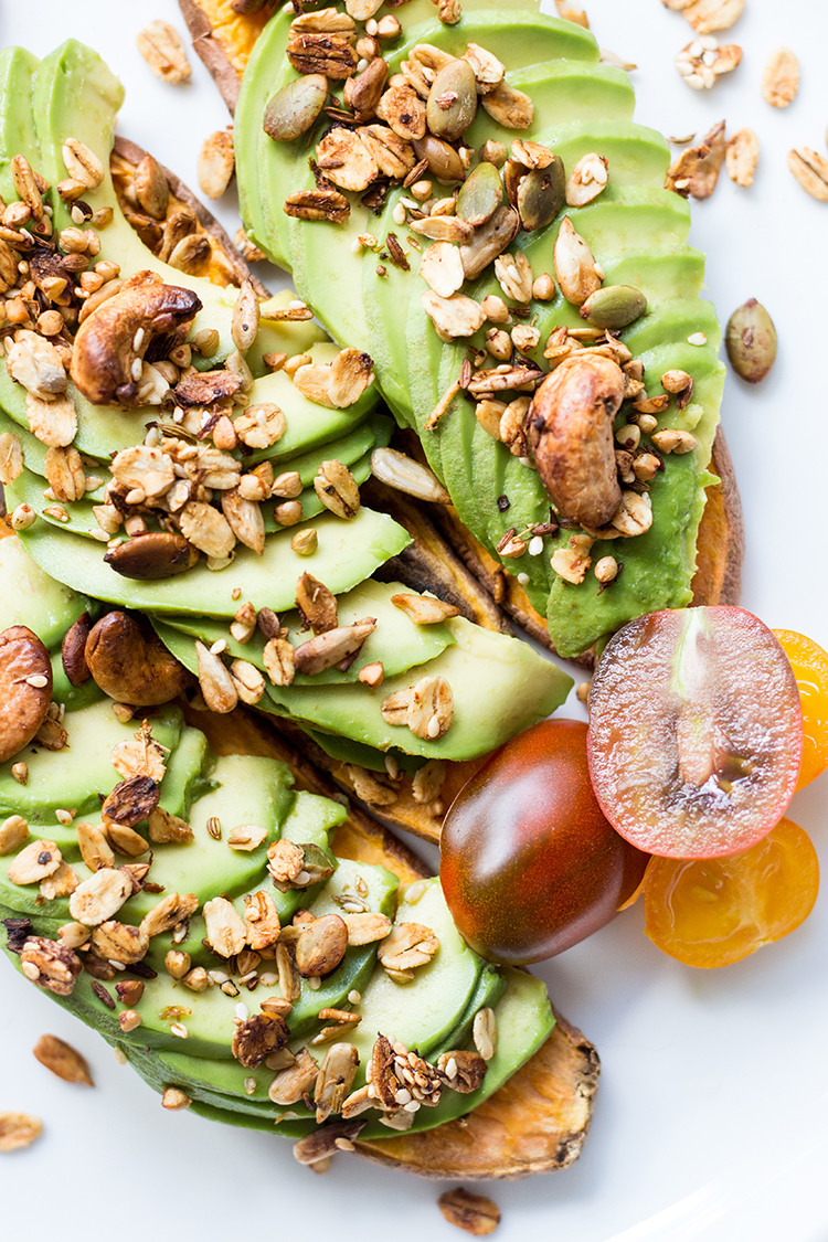 Savory granola sprinkled on sweet potato toast topped with avocado (vegan and gluten free).