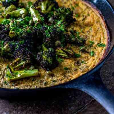 Farinata with charred broccoli, lemon and capers (vegan and gluten free).