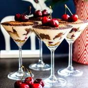 Vegan Christmas tiramisu with kirsch and cherries.