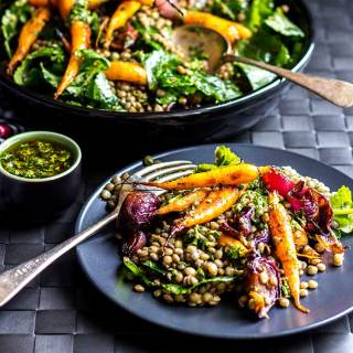 Lentil salad with roast baby carrots and red onions, dressed with chimichurri sauce (vegan and gluten free).