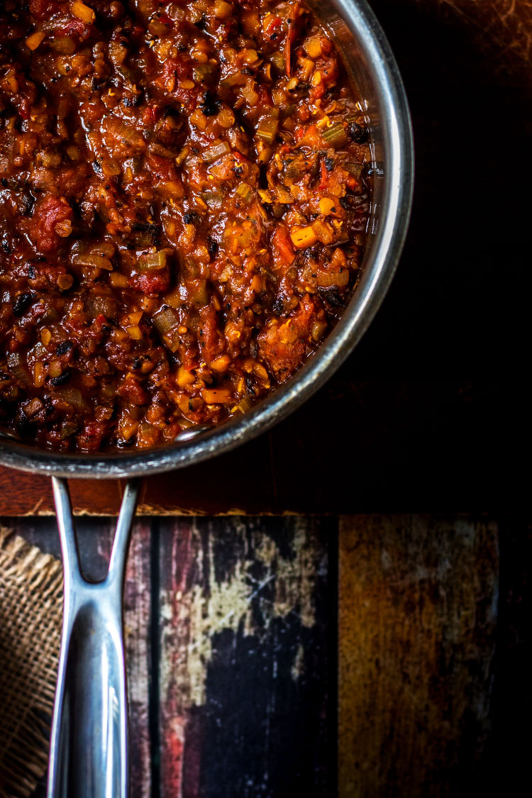 Overhead photo of a saucepan full of mushroom and lentil vegan bolognese sauce.