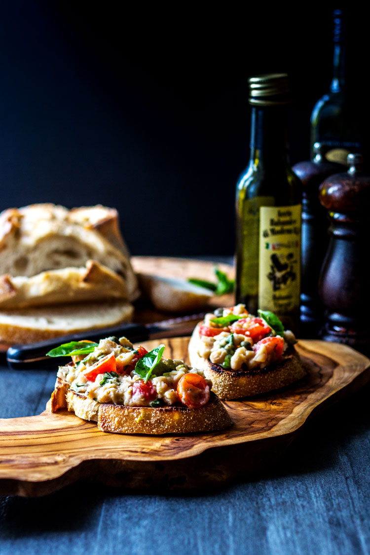 Cannellini bean and cherry tomato bruschetta (vegan).