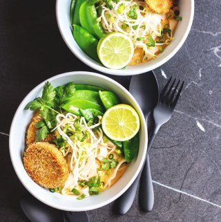 Thai curry noodles with chilli and lime cakes (vegan).