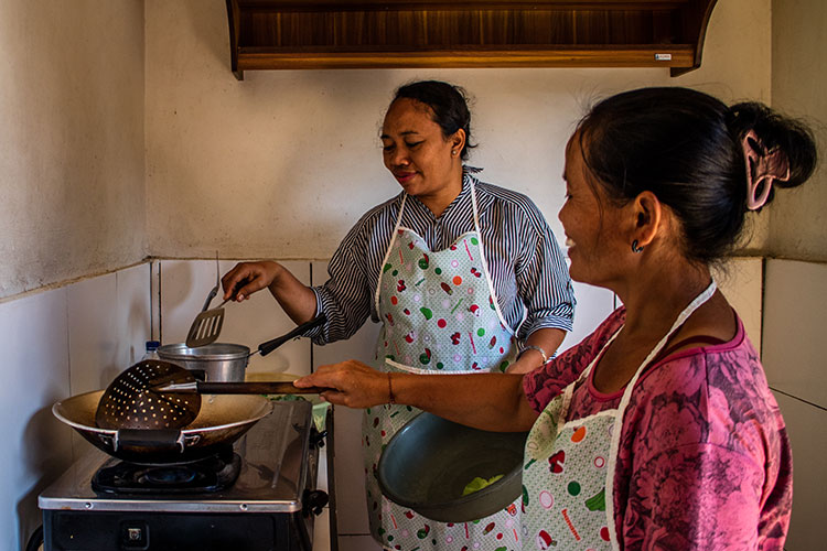 Putu and her sister in law, during a cooking class with Traveling Spoon.