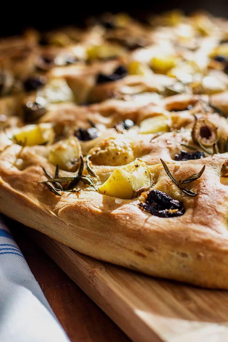 Potato foccacia with olives and rosemary (vegan).