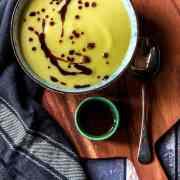 Saffron-infused cauliflower soup with sumac oil
