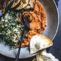 Quinoa, kale and eggplant bowl with muhammara