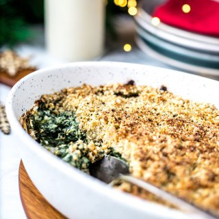 Creamed spinach gratin with a seedy crumb topping