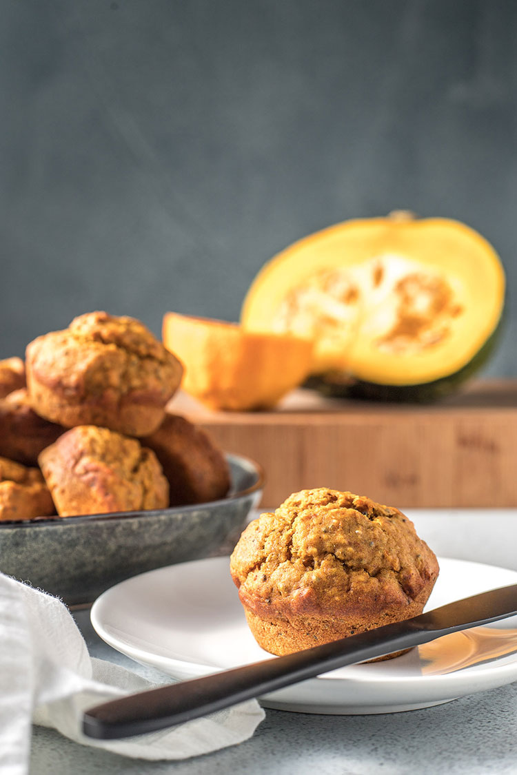 Vegan pumpkin, orange and chia seed muffins, on a plate and ready to serve.