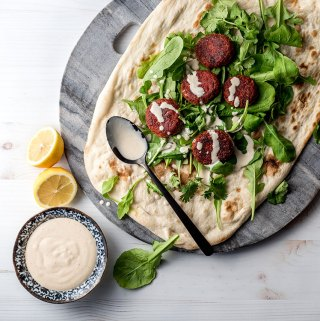 Beetroot falafel with tahini sauce.