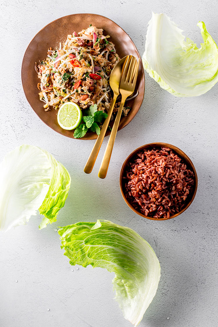 Cauliflower, peanut and tofu larb served with red rice and iceburg lettuce leaves (vegan and gluten free).