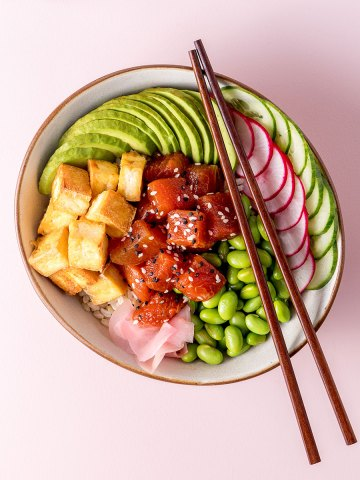 A bowl with edamame beans, sliced radish, cucumber and avocado, fried tofu and marinated watermelon visible.