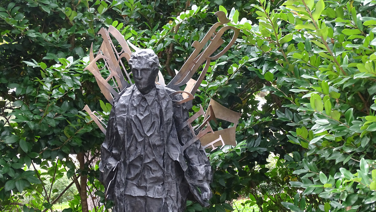 Standing Man with Radiating Words by Lesley Dill - Besthoff Sculpture Garden