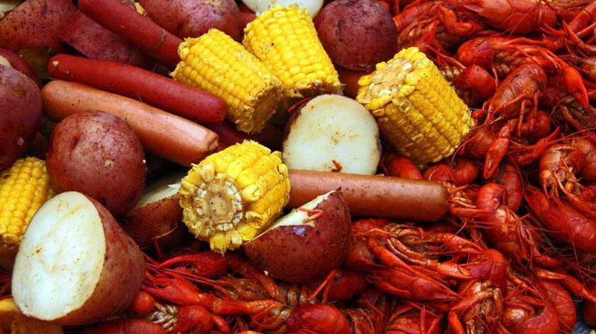 Boiled crawfish with corn, potatoes and hot dogs - Copyright: Ken Durden