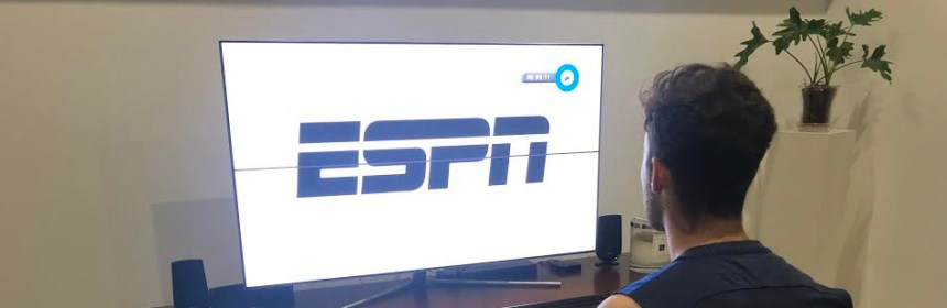QU student watches ESPN on TV