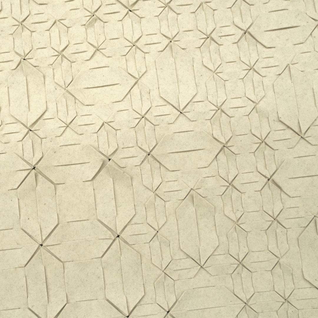 Wol wit vloerkleed met een patroon van verschillende Qvilt elementen