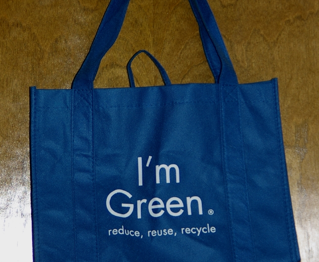 A BLUE fabric shopping bag with emblazoned the trendy caption, I'm Green. reduce reuse recycle