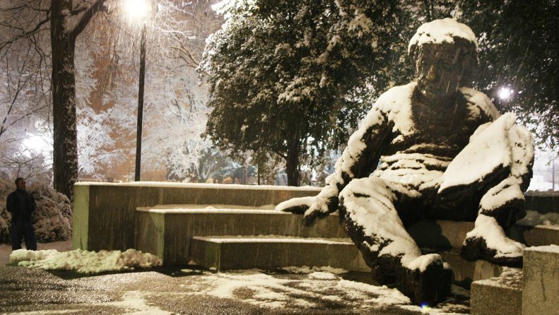 Einstein statue in the snow.