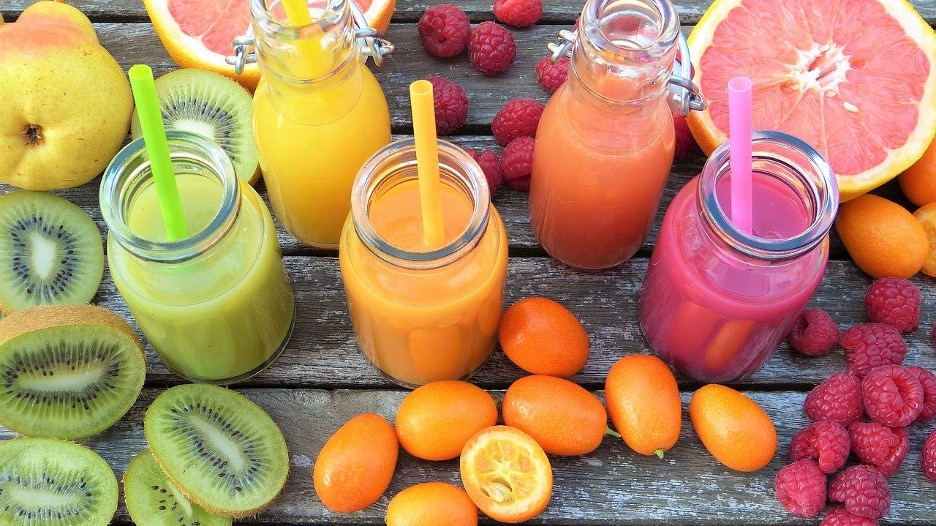 A bunch of fruits and juices on the table