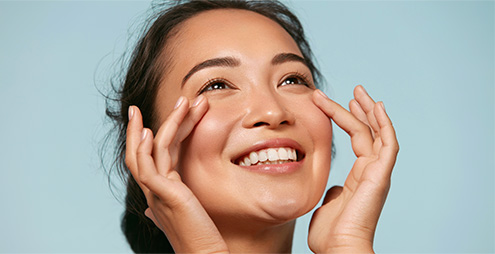 Women applying anti-aging cream on her face - R2 Medical Clinic